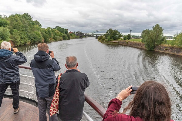 Passengers taking photographs of the Manchester Ship Canal